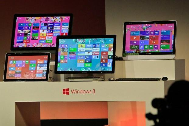 Microsoft is hoping the way Windows 8 looks and operates will appeal to the growing number of people embracing the convenience of smartphones and tablets. Photo: AFP